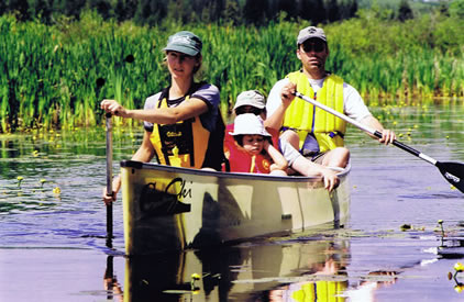 Family canoeing in Prince Albert National Park