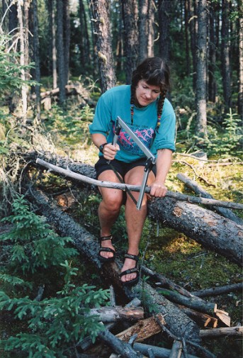 Preparing firewood on the CanoeSki all women's canoe trip