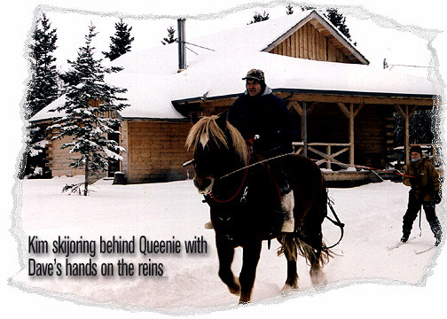 Kim skijoring behind Queenie with Dave's hands on the reins