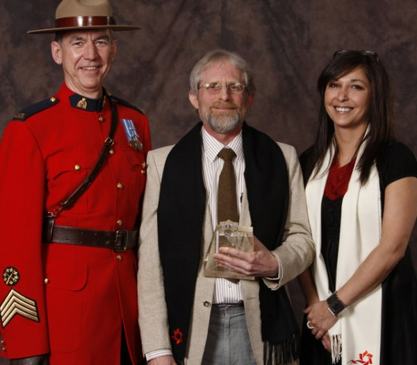 Cliff Speer holding Tourism Saskatchewan Award